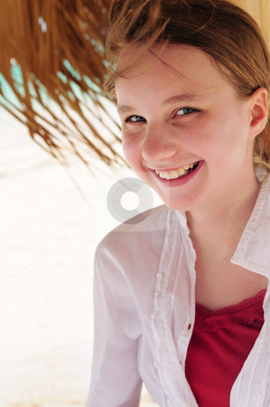 Young girl on tropical beach  stock photo, Portrait of a young girl on tropical beach under umbrella by Elena Elisseeva