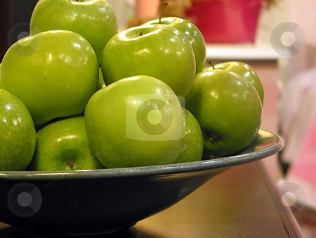 Green apples bowl stock photo, Green apples in a bowl on kitchen countertop by Elena Elisseeva