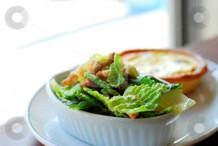 Caesar salad and quiche stock photo, Caesar salad and quiche on white plate by Elena Elisseeva