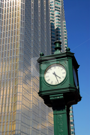 City clock stock photo, Old public clock with tall modern skyscraper in the background by Elena Elisseeva
