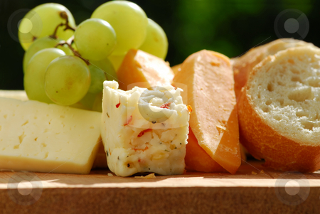 Cheeses stock photo, Assorted cheeses with grapes and white bread by Elena Elisseeva