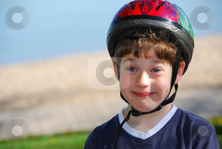 Little boy portrait stock photo, Portrait of a cute little boy in bicycle helmet making silly faces by Elena Elisseeva
