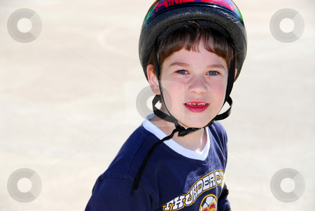 Little boy smile stock photo, Portrait of a little boy rollerblading in a helmet by Elena Elisseeva