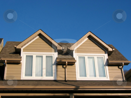 New home fragment stock photo, Fragment of a new custom built house on the background of bright blue sky by Elena Elisseeva