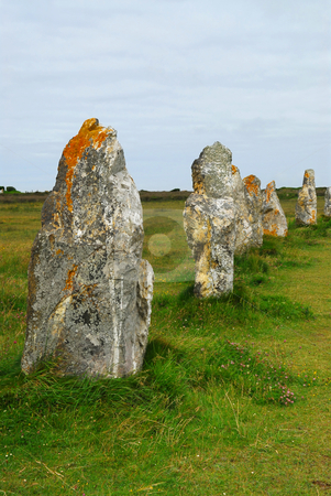Megalithic monuments in Brittany stock photo, Row of prehistoric megalithic monuments menhirs in Brittany, France by Elena Elisseeva