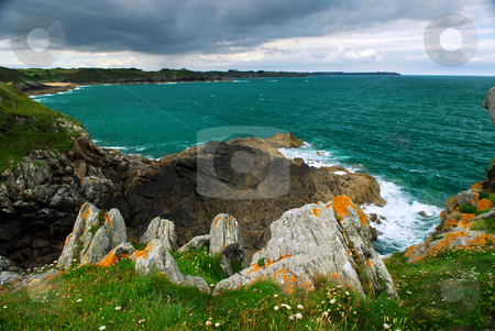 Brittany coast stock photo, Emerald waters of Atlantic ocean at the rocky coast of Brittany, France by Elena Elisseeva