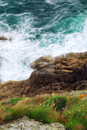 Brittany coast stock photo, Looking down a cliff onto stormy ocean at the rocky coast of Brittany, France by Elena Elisseeva