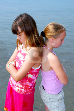 Two girls pouting stock photo, Portrait of two girls pouting by Elena Elisseeva