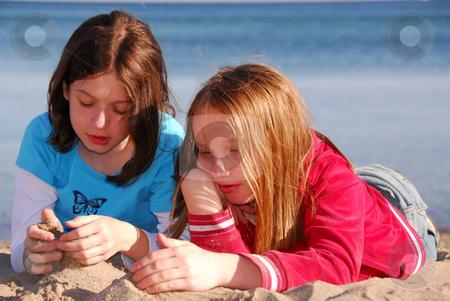 Girl friends talking stock photo, Girlfriends talking on a beach by Elena Elisseeva