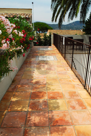 Courtyard of a villa stock photo, Courtyard of mediterranean villa in French Riviera with ceramic tile walkway by Elena Elisseeva