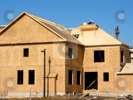New home construction stock photo, Construction of a new home with workers on roof by Elena Elisseeva