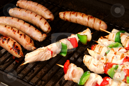 Barbecue stock photo, Sausages and chicken kebabs on a barbecue by Elena Elisseeva