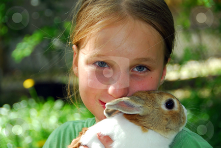 Girl and bunny stock photo, Young girl holding a bunny by Elena Elisseeva