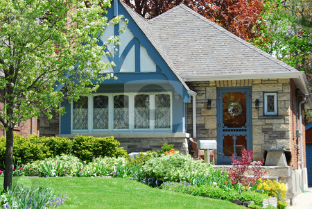Charming house stock photo, Charming house with nice landscaping by Elena Elisseeva