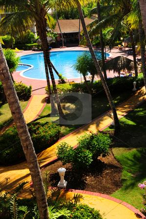 Garden landscaping at tropical resort stock photo, Swimming pool and garden landscaping at tropical resort by Elena Elisseeva