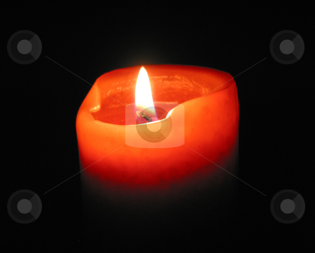 Burning candle stock photo, Red candle burning in the dark by Elena Elisseeva