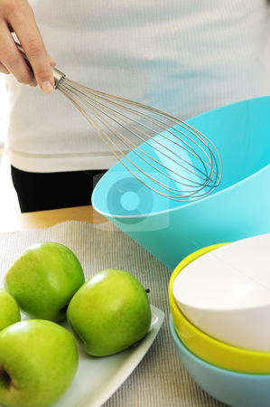 Cooking stock photo, Woman preparing food with whisk and bowl by Elena Elisseeva