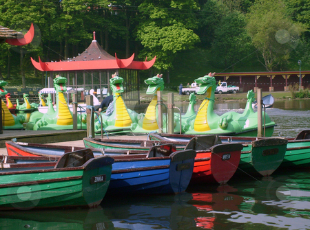 Dragon boats on boating lake stock photo, Dragon boats on boating lake in Peasholm Park, Scarborough, England. by Martin Crowdy