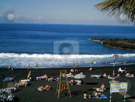 Tenerife Beach stock photo, Tourists on beach at Playa de La Arena on island of Tenerife, Spain. by Martin Crowdy