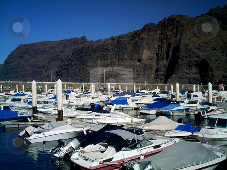 Boats moored by Los Gigantes stock photo, Boats moored by Los Gigantes cliiffs on island of Tenerife, Spain. by Martin Crowdy