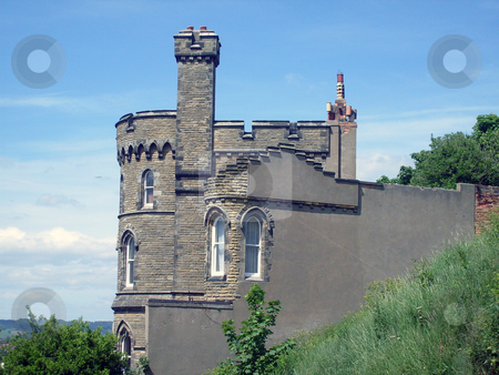 Historic castle shaped house stock photo, Historic house sahped like a castle with battlements and turrets. by Martin Crowdy