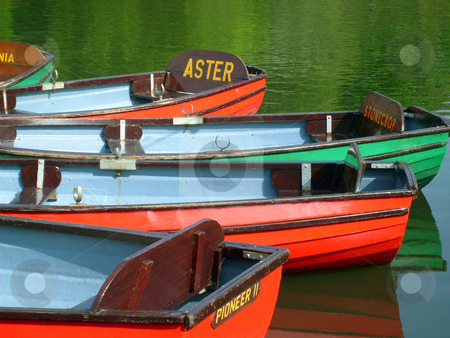 Colorful boats on boating lake stock photo, Colorful boats on boating lake in Peasholm Park, Scarborough, England. by Martin Crowdy