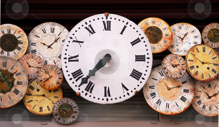 Antique clocks stock photo, Several antique clock faces of different sizes and styles by Elena Elisseeva