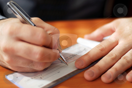 Man writing a check stock photo, Closeup on man`s hands writing a check by Elena Elisseeva