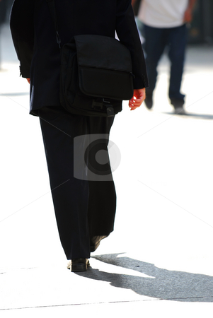 Businessman walking stock photo, Businessman walking on a busy street downtown by Elena Elisseeva