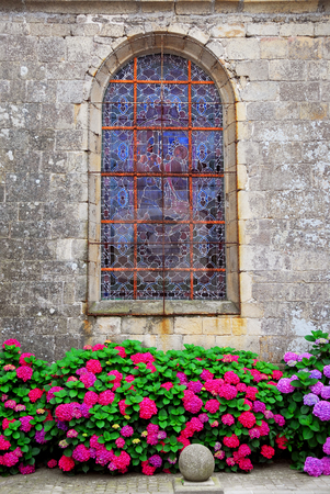 Church window in Brittany stock photo, Stained glass church window on Carnac, Brittany, France. by Elena Elisseeva