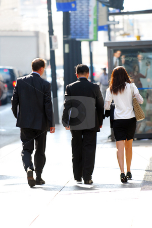 Business people stock photo, Business team walking on a sidewalk in busy city center by Elena Elisseeva