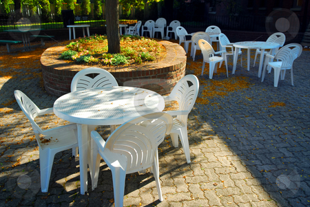 Outdoor cafe stock photo, Empty tables of outdoor cafe in the fall by Elena Elisseeva