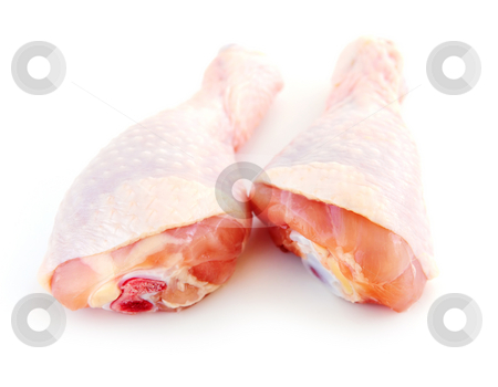 Raw chicken drumsticks stock photo, Raw chicken drumsticks isolated on white background by Elena Elisseeva