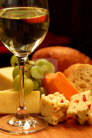 Wine tasting stock photo, Glass of white wine and assorted cheeses for wine tasting by Elena Elisseeva