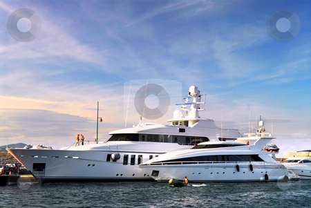 Luxury yachts stock photo, Large luxury yachts anchored at St. Tropez in French Riviera by Elena Elisseeva
