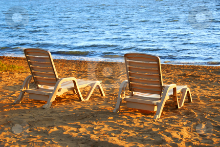 Beach chairs stock photo, Beach chairs on sea shore in late afternoon by Elena Elisseeva