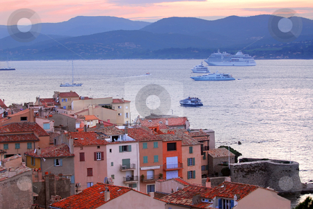 St.Tropez at sunset stock photo, View at St.Tropez and anchored ships at sunset in French Riviera by Elena Elisseeva