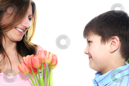 Mother and son with flowers stock photo, Mother receiving a bouquet of flowers from her son by Elena Elisseeva
