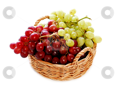 Grapes in a basket stock photo, Grapes in a basket isolated on white background by Elena Elisseeva
