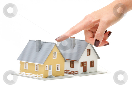 Choosing A Home stock photo, Female hand pointing at a house isolated on a white background. by Andy Dean