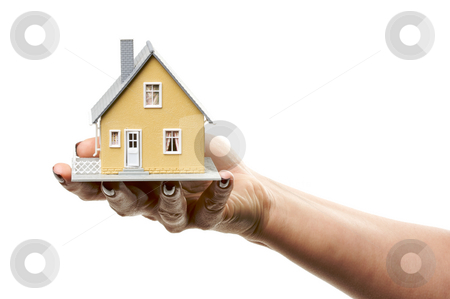 House in Female Hand stock photo, Female hand holding a house isolated on a white background. by Andy Dean