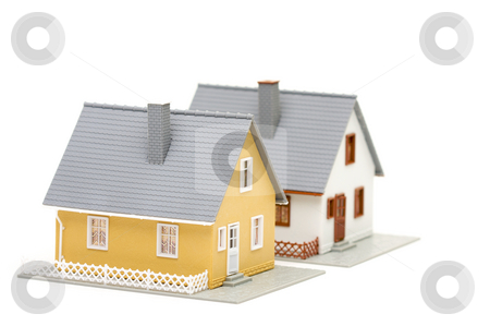 Pair of Homes stock photo, Pair of small houses isolated on a white background. by Andy Dean