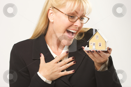 Excited Female Holding House stock photo, Female holding small house. by Andy Dean