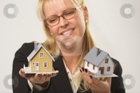Woman Holding Two Houses