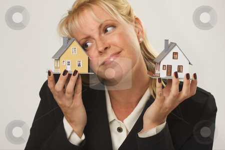 Houses in Female Hands stock photo, Female dreaming while holding two houses. by Andy Dean