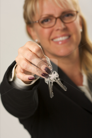 Woman Presenting Keys stock photo, Female presenting keys. Narrow depth of field. by Andy Dean