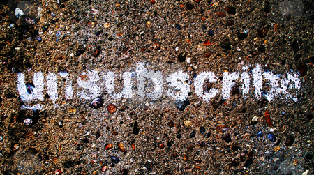 Unsubscribe Graffiti stock photo, A stencilled graffiti word Unsubscribe, could be used as a button on a website or as a social protest statement by Philippa Willitts