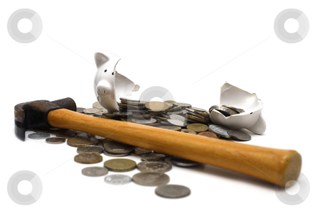 Broken Piggy Bank stock photo, A broken piggy bank isolated on a white background with loads of coins from around the world and a hammer. by Daniel Wiedemann