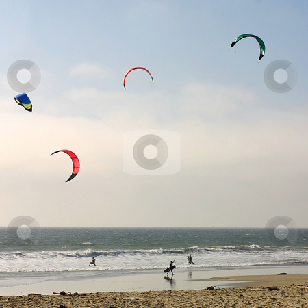 Kite Surfing stock photo, Surfer with colorful kites at the beach. by Henrik Lehnerer
