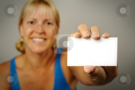 Woman with Blank Business Card stock photo, Smiling Woman Holding Blank Business Card. Room for text, or your own message. by Andy Dean